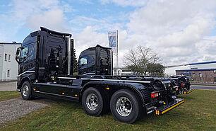 VDL Abrollkipper S21-6200 auf Volvo Fahrgestell - seitlich